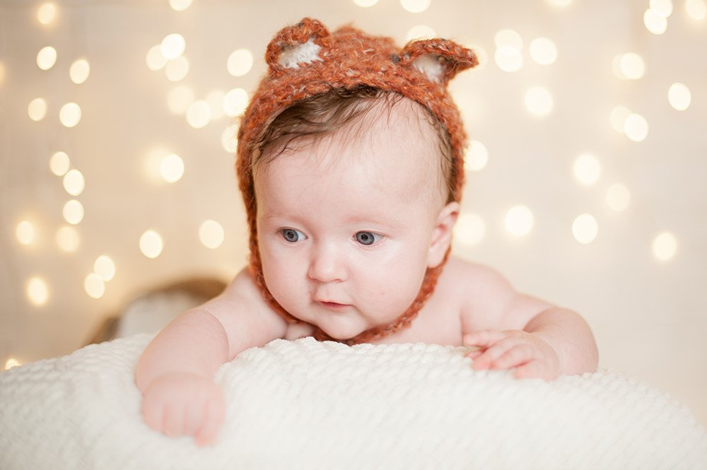 Baby photoshoot in Southampton wearing fox bonnet