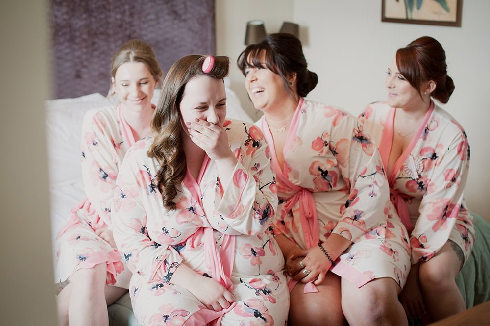 Bridesmaids in floral dressing gowns at Christchurch Harbour Hotel