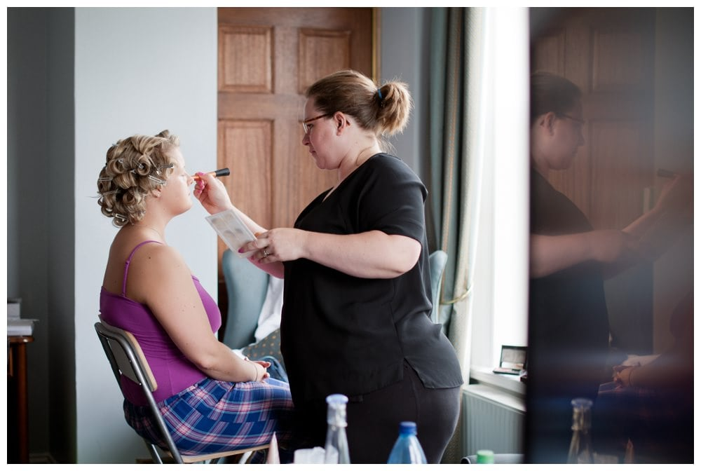 Bride having make-up applied at New Forest Hotel