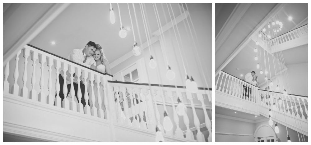 Black and white photographs of Bride and groom on staircase at Balmer Lawn