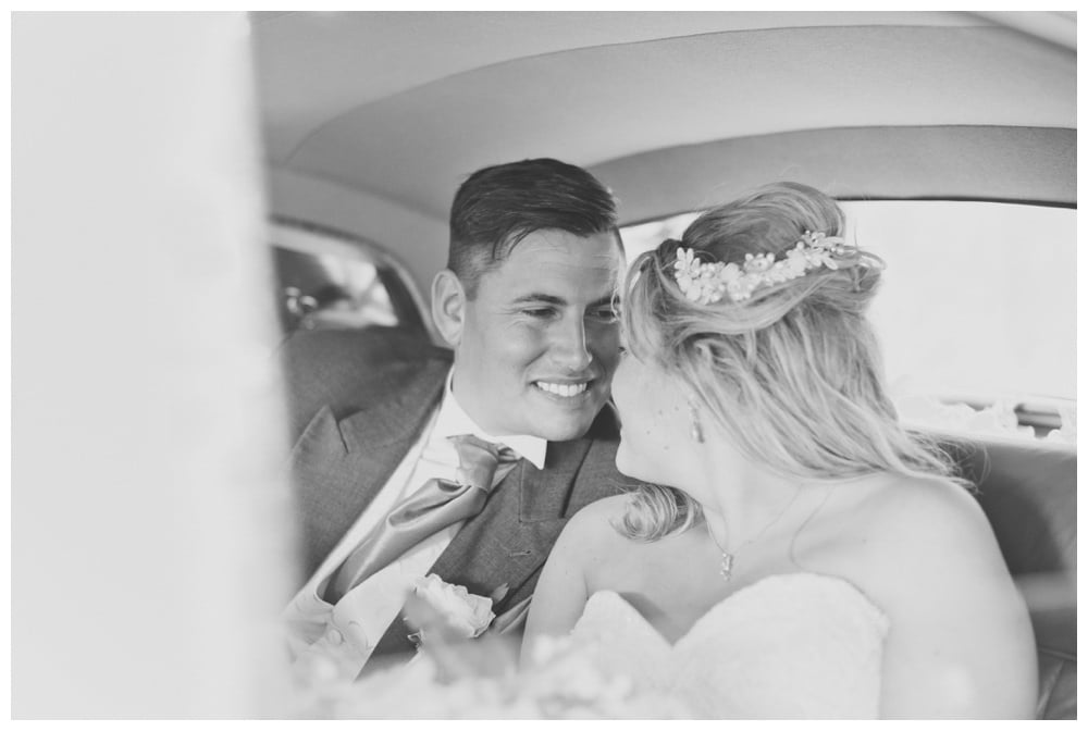 Bride and groom in Rolls Royce