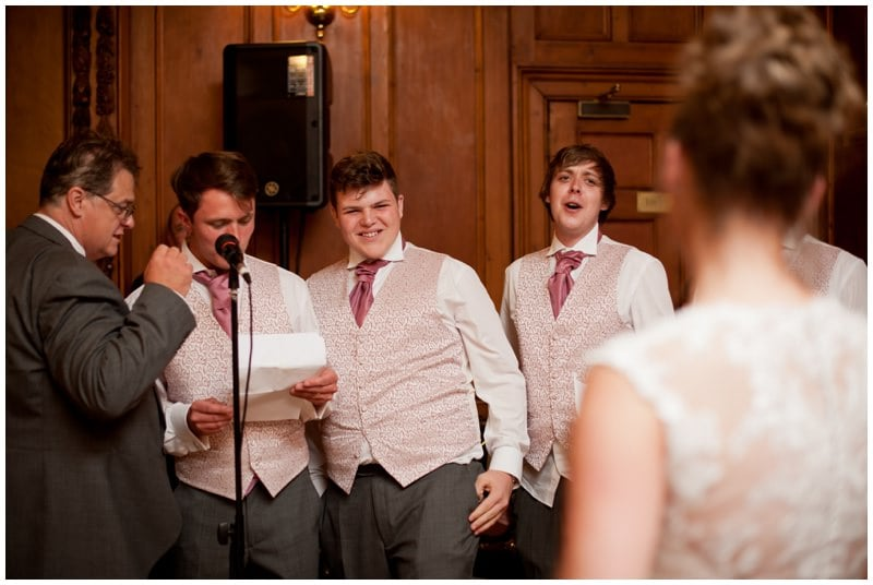 Photograph of Groom and family singing to Bride