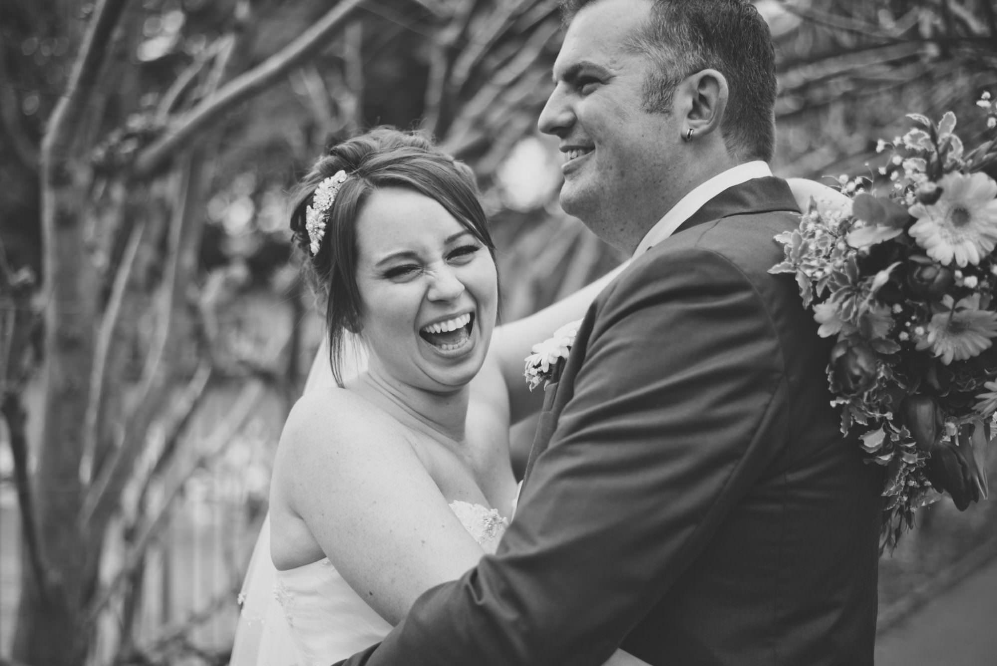 Bride laughing at Christchurch Wedding
