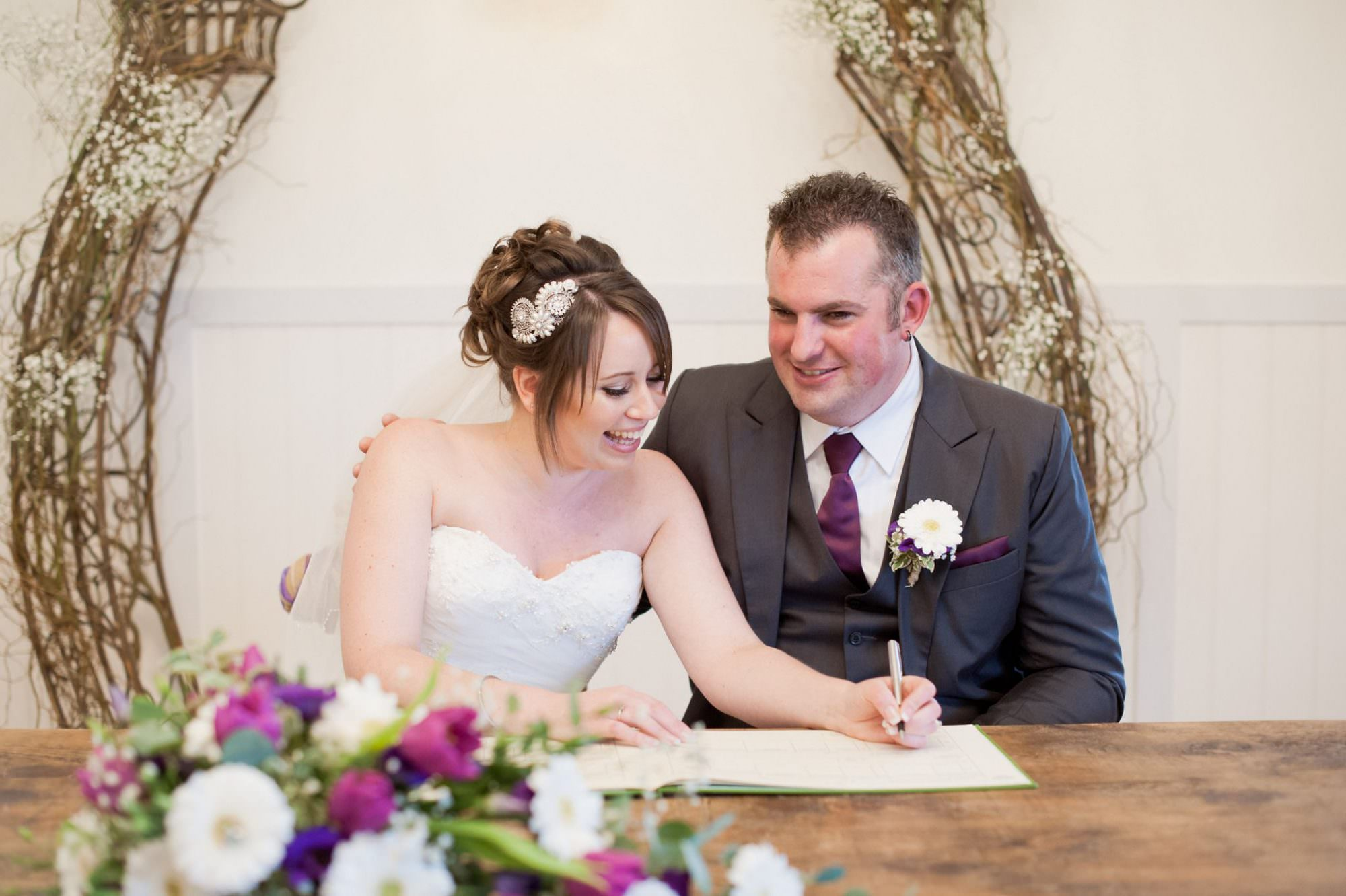 Signing the Register at Kings Arms Hotel Wedding