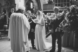 Singing hymns at Canford magna church wedding