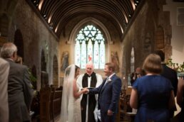 Ring exchange at Canford magna church wedding