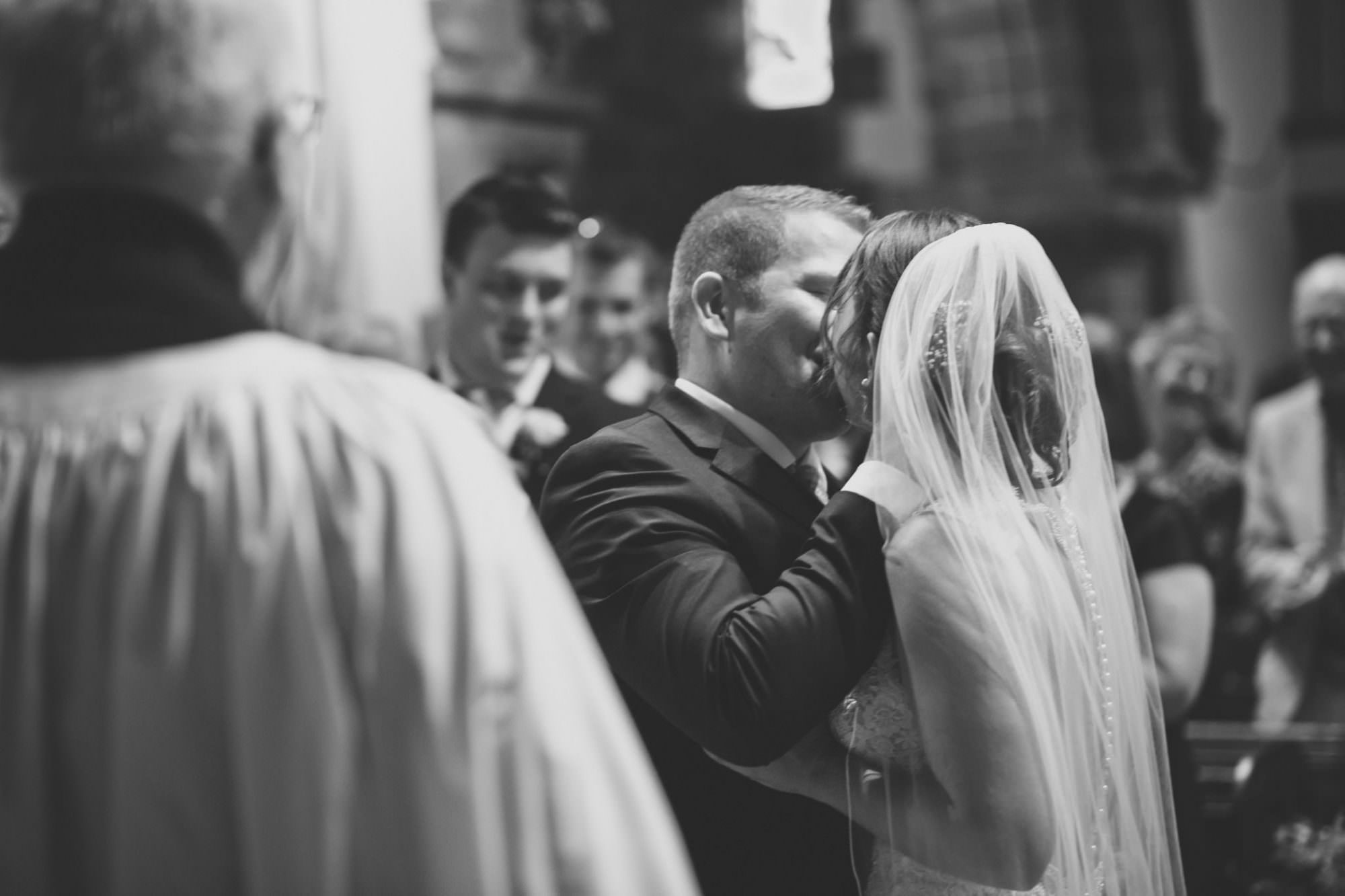 First Kiss at Canford magna church wedding