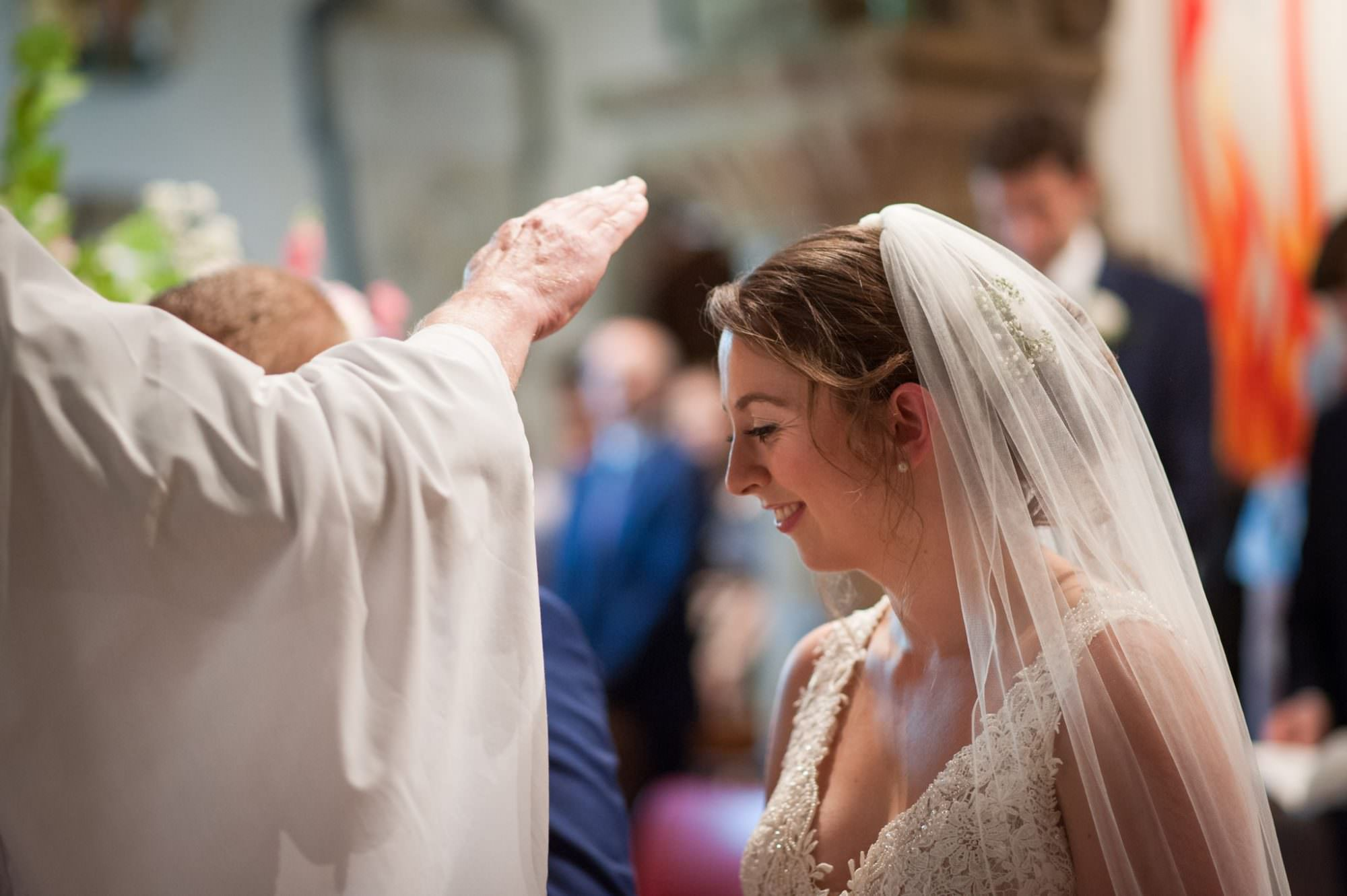 Wedding prayer at Canford magna church wedding