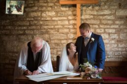 Signing wedding register at Canford magna church wedding