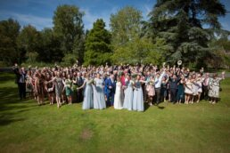 Group photograph at Canford magna church wedding