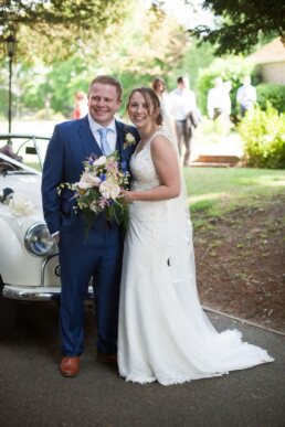 Bride and groom with Morris Minor in Dorset