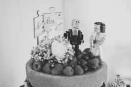 Dorset naked wedding cake with Lego cake toppers