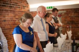 Saying grace at Sopley Mill wedding breakfast