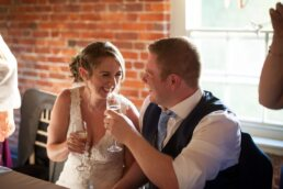 Happy couple married at Canford Magna Church