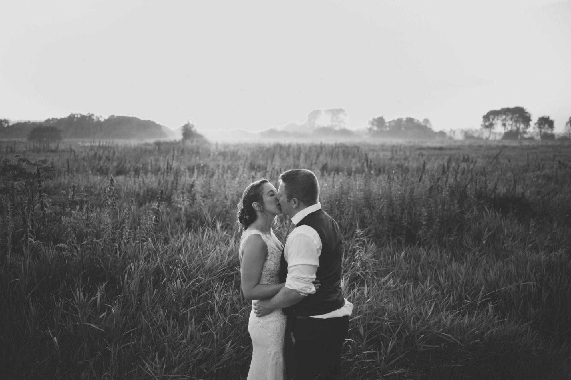 Wedding couple during golden hour mist at Sopley Mill