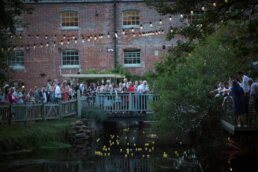 Dorset wedding photography at Sopley Mill duck race fun