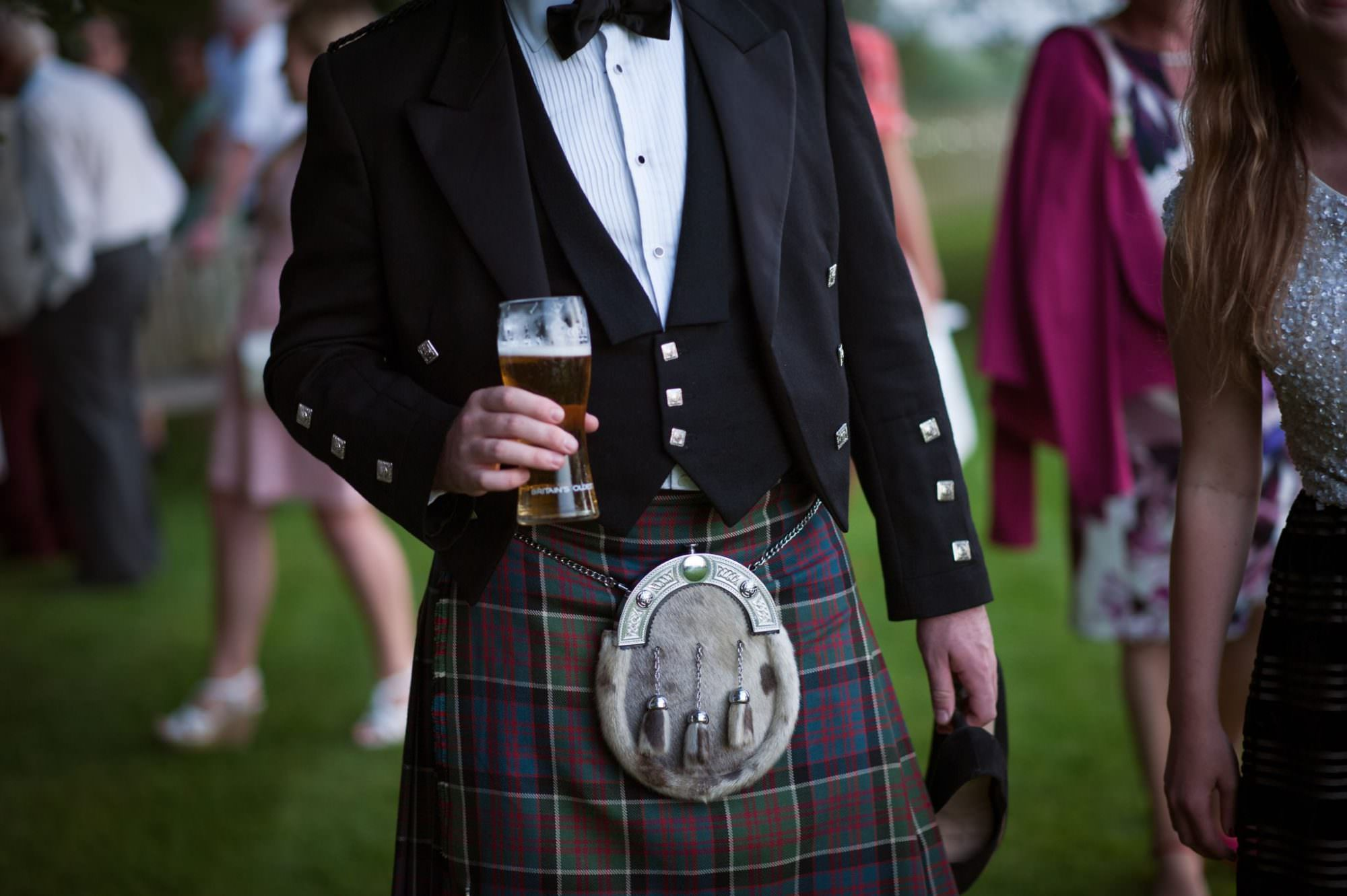 Guest wearing kilt at Dorset wedding