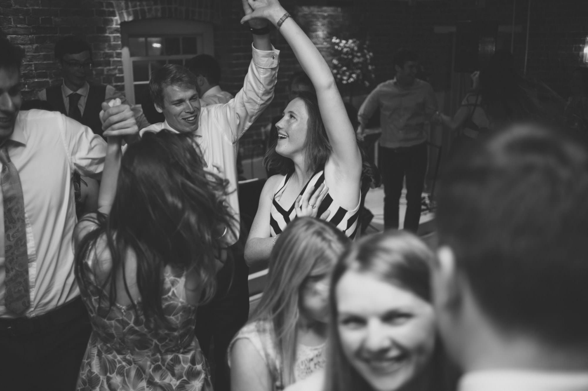 Guests dancing at Sopley Mill wedding
