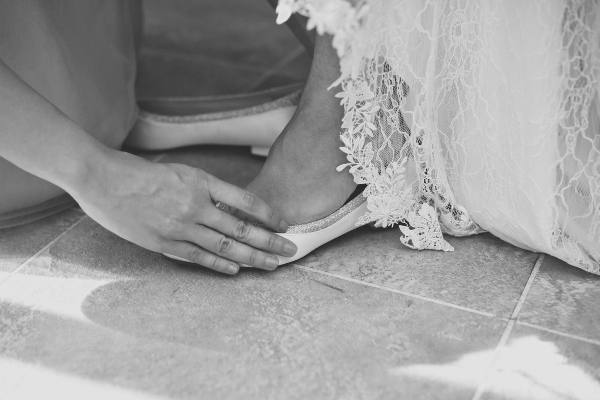 Dorset bride putting on Rainbow Bridal shoes