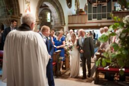 bride and groom at Canford magna church wedding in dorset