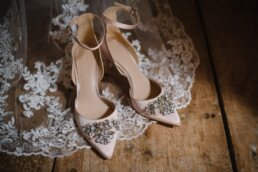 Photograph of pale pink bridal shoes at Dorset wedding