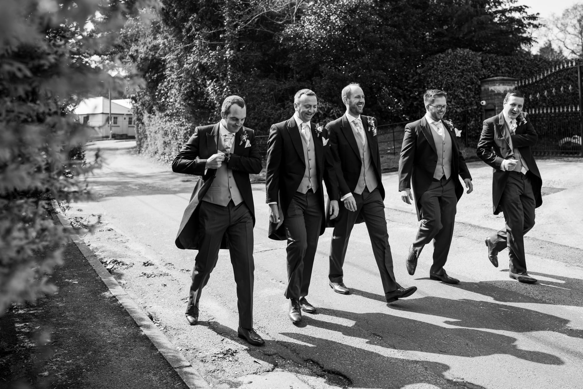 Sopley Mill groomsmen walking to the pub