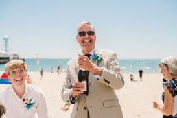 Champagne at Bournemouth beach wedding