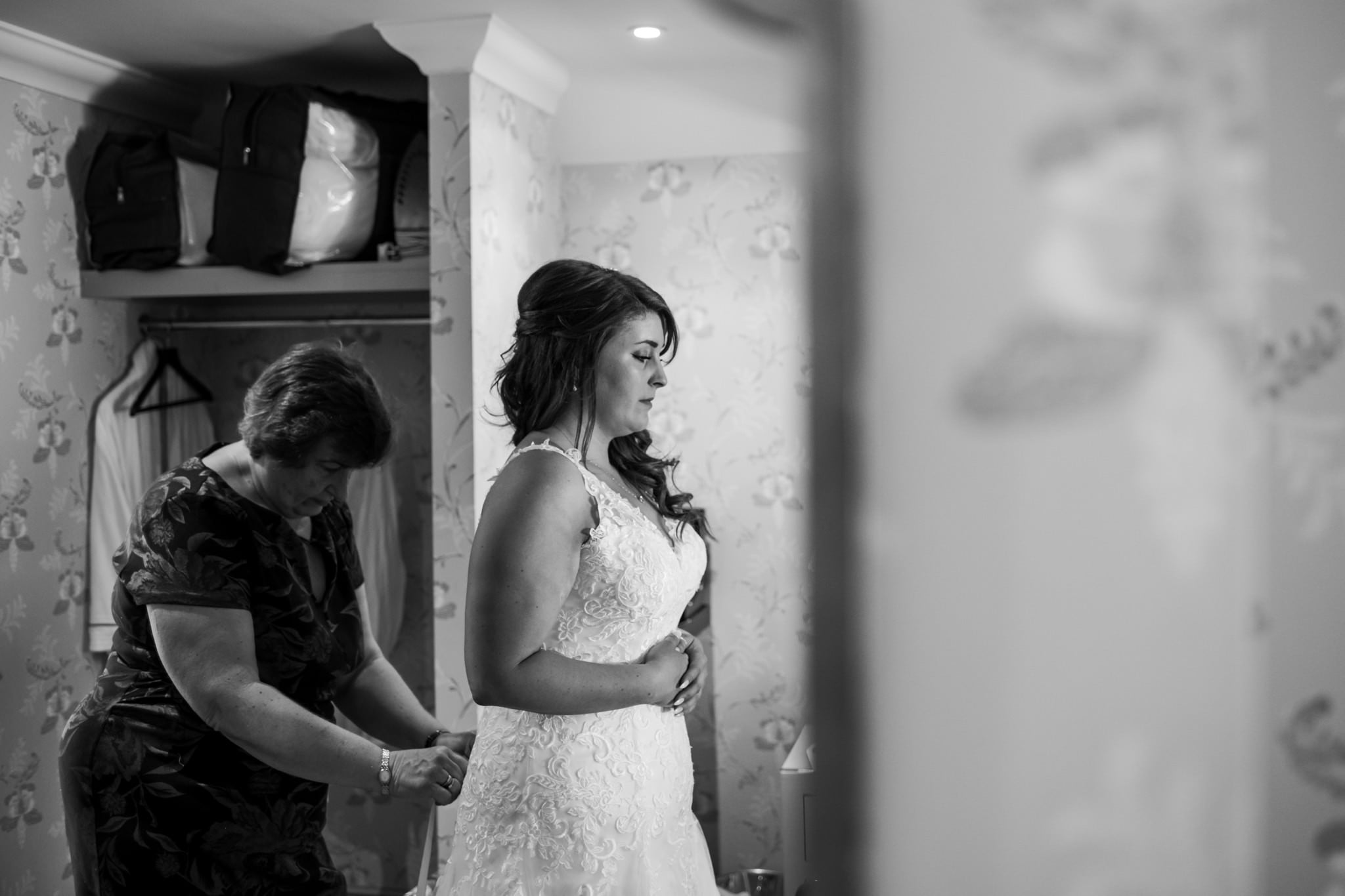 Photo of bride getting into dress at Gordleton Mill