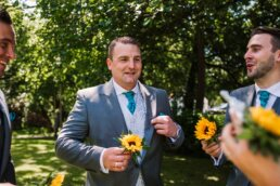 Groom with sunflower buttonholes at Gordleton Mill wedding