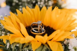 Photo of wedding rings in sunflower bouquet at Gordleton Mill