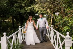 Couple on bridge at Gordleton Mill wedding