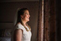 Photography of gay brideat Three Choirs Vineyard wedding