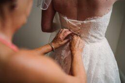 Lace up wedding corset dress at Three Choirs Vineyard wedding