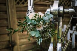Quirky photography of bouquet at Gordleton Mill Wedding