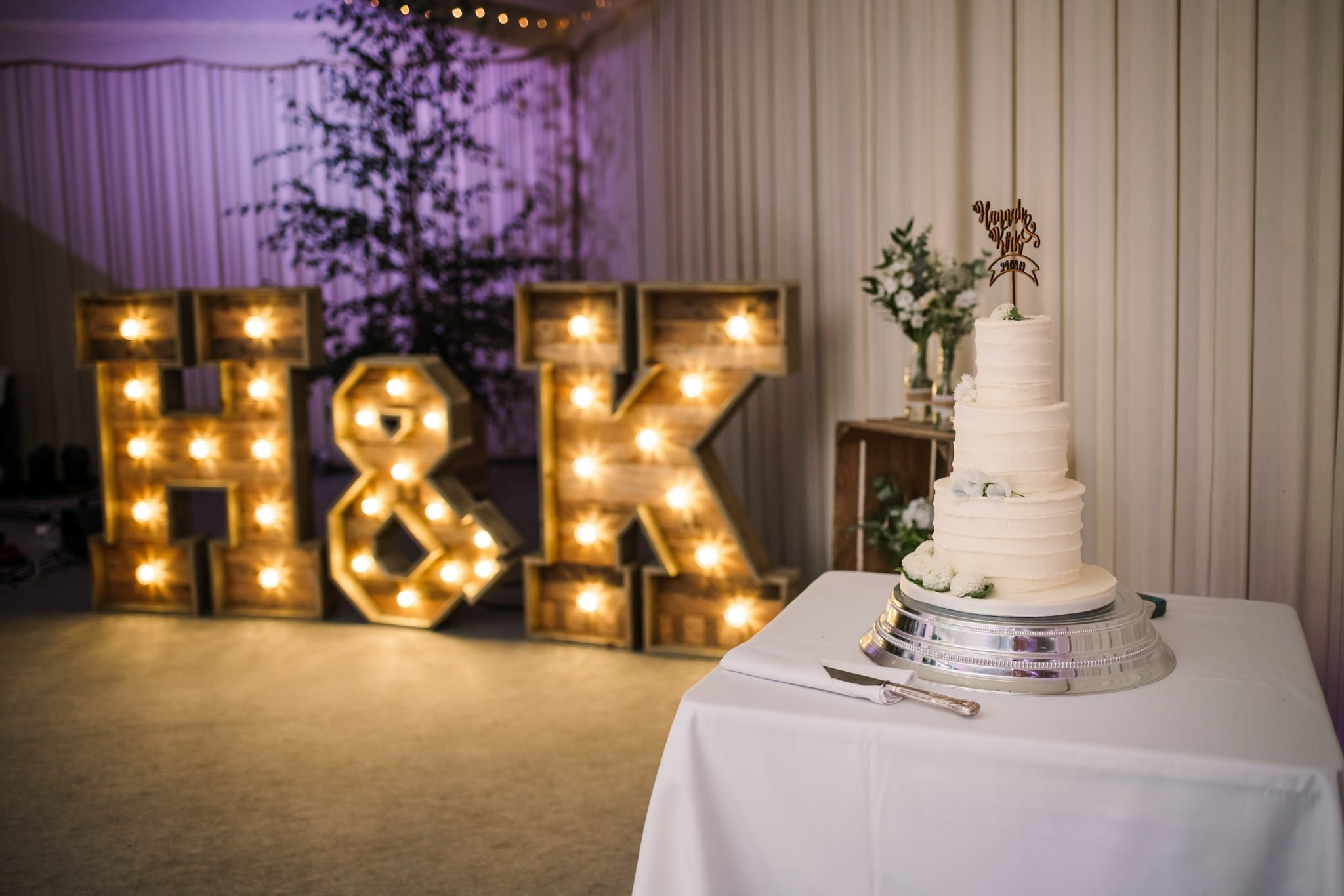 Wedding cake and light up letters at Gordleton Mill Wedding