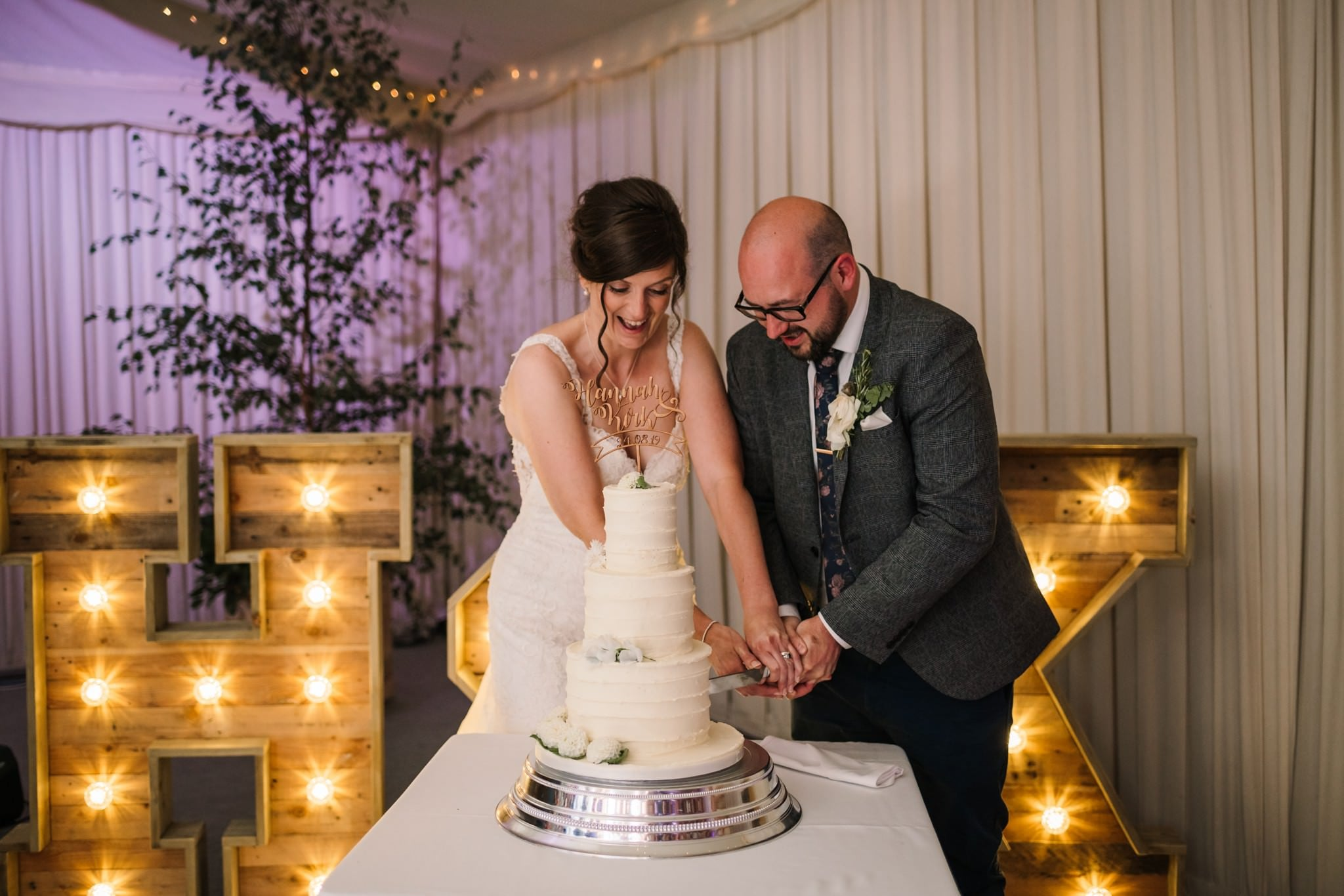 Cutting the cake at Gordleton Mill Wedding Photography